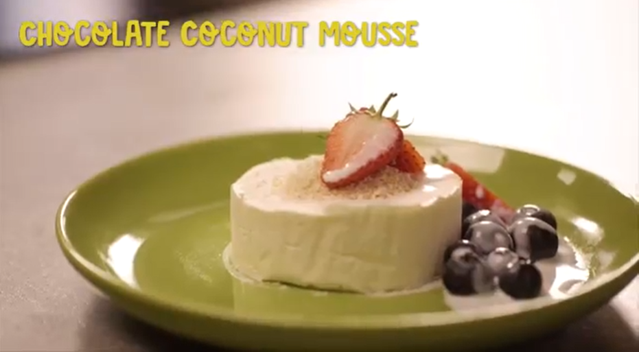 White Chocolate Coconut Mousse topped with fresh berries and served on plate