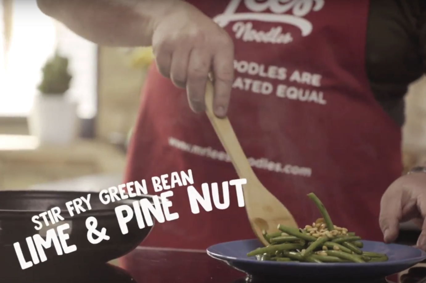 Recipe for stir-fried green beans with line and pine nuts on plate
